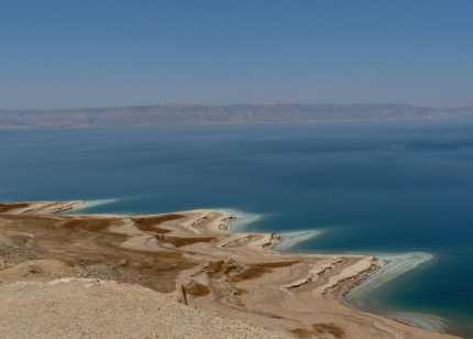 Across the Dead Sea, lined with salt, lies Israel